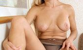 Anilos Viktoria 22940 Busty Anilos Viktoria caresses her clitoris on top of her desk