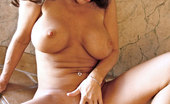 Anilos Victoria Valentino Glamorous brunette Anilos plays with her delicate pink milf pussy by the jacuzzi