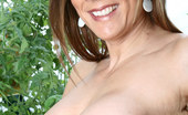 Anilos Victoria 22958 Brunette Anilos Victoria loves to expose her experienced shaved pussy while she hangs out in her garden