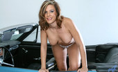 Anilos Victoria 22961 Busty Anilos Victoria slips off her dress and exposes her cougar pussy in a hot car