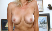 Anilos Veronica 22962 Totally naked blonde milf loves to fondle her pink mature snatch while lying on a carpeted floor