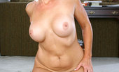 Anilos Veronica 22963 Blonde cougar Veronica flaunts her mature nude body and her huge boobs