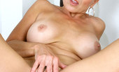 Anilos Veronica 22964 Horny housewife Veronica pops out her huge tits while spreading her mature pussy with the handle of a feather duster