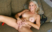 Anilos Veronica 22965 Sexy Anilos cougar Veronica wears red lingerie as she starts to masturbate with a dildo on the sofa