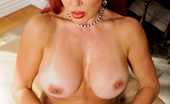 Anilos Vanessa Bella 22983 Red haired cougar Vanessa Bella stuffs her milf pussy with a glass toy
