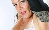 Anilos Vanessa Sophisticated Anilos milf takes off her panties and lifts up her skirt to show us her hairy pussy