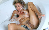 Anilos Vanessa 22988 Experienced cougar Vanessa enjoys her bubble bath with a black vibrator banging her wet hairy pussy