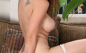 Anilos Valarie 22997 Seductive Anilos Valarie gets naked on the sofa and feeds her milf pussy a vibrator
