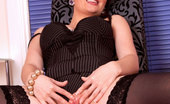 Anilos Tibby Elegant Anilos cougar strips off her clothes and spreads her legs widely for a perfect view of her pink pussy