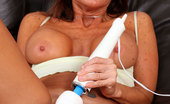 Anilos Tara Holiday Brunette cougar proudly displays her big tits as she plays with her trusty vibrator