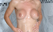 Anilos Tanya Tate Alluring mature babe Tanya Tate gently strokes her pussy with the rabbit toy while showering