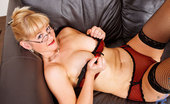 Anilos Suzy Classy businesswoman loosens up on the sofa and pleasures her seasoned milf pussy