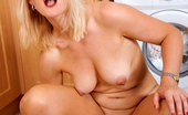 Anilos Suzy Steamy blonde cougar Suzy bangs herself with a dildo then widely spreads her mature snatch