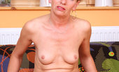Anilos Susan Lee 23085 Seductive blonde milf bares her fair skinned mature body and fondles her juicy snatch for a solo orgasm