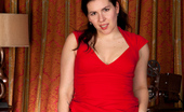 Anilos Sharlyn Horny cougar slips off her red dress and spreads her furry cream filled twat