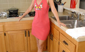 Anilos Sara James Anilos mom Sara James takes off her panties and plays her black vibrator in the kitchen