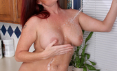 Anilos Sandi Lymm Housewife cools her warm moist pussy after working around the house