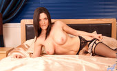 Anilos Rebekah Dee Hot Anilos babe spreads her pussy lips to display her pink clit on her bed