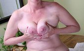Anilos Ray Lynn Naughty executive granny takes a quick break to strip off her clothes and flaunt her tits and pussy