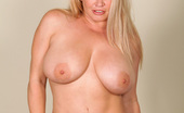 Anilos Rachel Love Blonde Anilos Rachel love teasingly removes her sexy red dress exposing her nude flesh