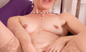 Anilos Poppy Playful cougar milf spreads her pink Anilos juice box before she masturbates in her bedroom