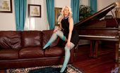 Anilos Olivia Jayne Hot blonde milf strips down and spreads her juicy twat