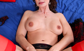 Anilos Nora Noir Nora Noir in red stockings spreads her juicy pussy