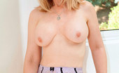 Anilos Nina Hartley Seductive cougar Nina Hartley stuffs her wet pussy with a glass toy