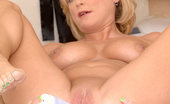 Anilos Lya Pink Totally nude cougar Lya Pink masturbates with a stiff dildo inside her bathroom