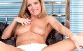 Anilos Louise Dakotah Milf Louise Dakotah flaunts her breasts and spreads her legs displaying her pussy