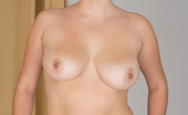 Anilos Leyla Brunette milf Leyla exposes her curvaceous nude cougar bod