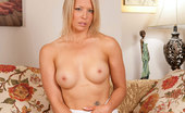 Anilos Lailani Sensual blonde milf Lailani spreads her silky thighs and caresses her cougar pussy