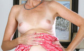 Anilos Katie Enticing mature mom spreads her pussy and dips her fingers inside making herself wet on the couch