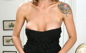 Anilos Jolie Sizzling Anilos Jolie peels off her evening wear and exposes her breast and pussy