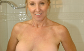 Anilos Jenna Covelli Dripping wet milf with big tits fucks a huge toy