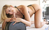 Anilos Darryl Hanah Platinum blonde Anilos milf titty fucks the sybian dong before sitting on it with her glistening pussy