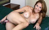 Anilos Crystal 24125 Classy Anilos milf Crystal is on her bed and banging her pussy with her rabbit toy
