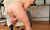 Anilos Catherine Desade Anilos milf Catherine Desade buries a glass dildo deep in her mature pussy