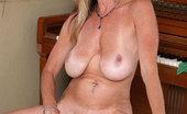 Anilos Cassy Torri Milf Cassy Torri flaunts her big tits and pleasures herself with a purple vibrator