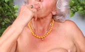 Anilos Betty Busty Anilos granny sucks her fingers and dips them deep within her needy hairy hole