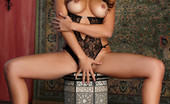 Twistys Katsuni Katsuni gently touches the length of her body before fingering herself.