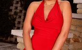 Twistys Regina Ice Regina Ice in a sexy red dress.