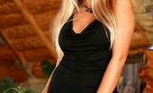 Twistys Anette Dawn Anette in black dress.