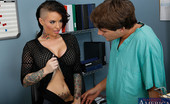 Naughty America Christy Mack 33802 Christy Mack is the hottest receptionist in the hospital. She's planning on getting a new tattoo soon, anywhere but her tits of course, she doesn't want anything to distract from her amazingly huge breasts. The doctor in the office agrees, the o