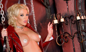 Penthouse Brenya Rose 36724 Brenya Rose, wickedly hot in her shiny thigh-high boots and diamond nipple caps, is going to whip you into shape with her leather paddles, whips , handcuffs and chains in her private sex dungeon.