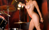 Penthouse Felony Felony, topless and pantyless,  rocks out on the drums onstage and then fingers her drumsticks while striking some sexy, provocative poses!