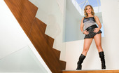 Penthouse Allie Foster Allie Foster catches our Penthouse cameras at crazy angles as she pops her naked big round boobs and ass flat up against and over the railing of a clear glass staircase banister!