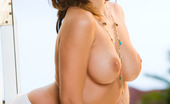 Penthouse Kelly Divine Kelly Divine brazenly shakes and thrusts her plump ass to grab your attention before spinning around and plopping down on it to play with her pussy and boobs!