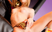 Penthouse Kasey Chase Trashy nympho Kasey Chase dons on a pair of flashy high-heeled fuck-me boots while posing nude on a leather couch!
