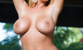 """Penthouse Sophie Dee """"My girls are picture perfect, wouldn't you agree?,"""" Sophie Dee coyly questions the Penthouse cameras, as she cups and squeezes her beautiful full 36DD milky white boobs!"""